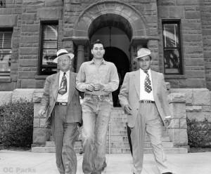 rdMcCrackenbeingescortedfromCourthouse,1951-52-02-1-72BG